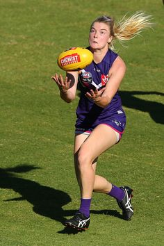 Hayley Miller of the Dockers marks the ball during the round six AFL Women's match between the Fremantle Dockers and the Carlton Blues at Domain Stadium on March 2017 in Perth, Australia. Celebrity Photos, Celebrity News, Perth Australia, Pop Culture, Blues, March, Football, Entertaining, Running