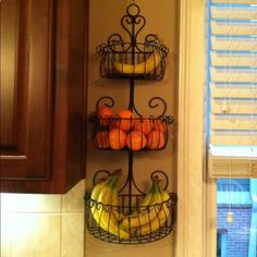 clever idea - use a garden wall planter to keep things off the counter;