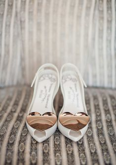 White peep-toe sandals with kitten heel and pretty rose gold heart detail. For more inspiration visit www.weddingsite.co.uk