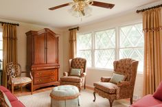 Very traditional living room with stationary draperies in a rich gold tones.