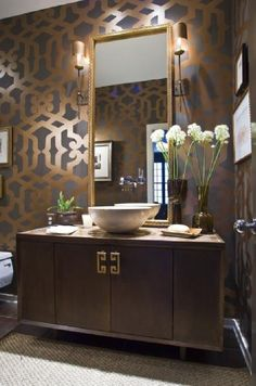 LOVE this wallpaper. Elegant bathroom!