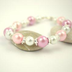 Armbånd av voksperler i to rosatoner og hvitt   http://epla.no/shops/dsignlauw/
