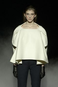 Hussein Chalayan FW 2011 | Shape is explored through folds and tucks within the garment. The big silhouette is balanced against figure hugging trousers. Interesting sleeve shape is generated through the structured form of the back which appears to be acting as a long sleeve.