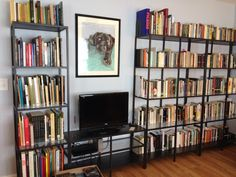 """IKEA VITTSJO shelving unit for TV and books! Great way to have storage without """"weighing down"""" a room. The metal and glass keeps things airy."""