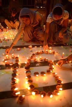 Indian Sikhs light oil lamps in the state of Punjab.
