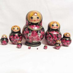 This Russian matryoshka nesting doll by artist Drachev Ludmila is painted in typical Sergiev Posad floral style.
