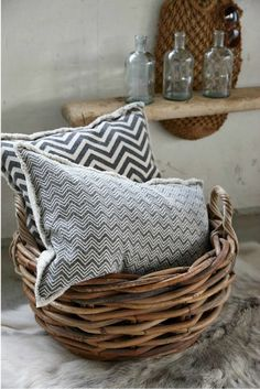 patterned pillows in basket