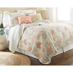 Seton Bay quilt set. Cotton quilt features a colorful coastal print and a striped reverse side #CoastalBeachDecor