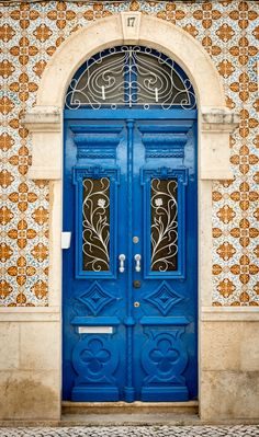 Blue door in a tile-covered (azulejo) building- Portimão, Portugal