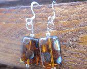 Polka dotted amber colored earrings