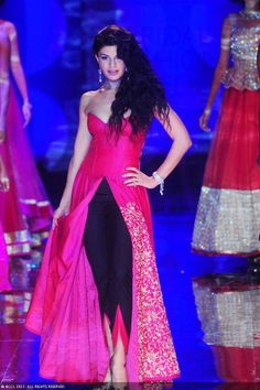 Jacqueline Fernandez walks the ramp to showcase a creation by designer Jyotsna Tiwari on Day 2 of the India Bridal Fashion Week (IBFW) 2013 at The Grand, Vasant Kunj in New Delhi