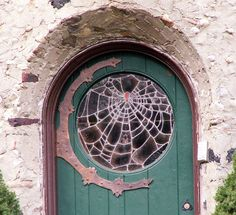 cobweb glass window in arch top door