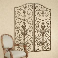 Turn your home into the entrance to a luxurious, stately residence with the Mateo Indoor/Outdoor Gate Wall Grille Set. Handcrafted of wrought iron and metal,. Wrought Iron Wall Decor, Wrought Iron Fences, Indoor Gates, Burglar Bars, Porch Makeover, Furniture Placement, Iron Art, Indoor Outdoor, Outdoor Decor