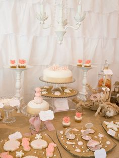 """Mystical Mermaid Party...create an underwater wonderland any girl would adore. a white ruffle shower curtain as a backdrop for the dessert table, which """"adds a perfect shabby chic element and looks like white ruffled waves — perfect for an under-the-sea"""