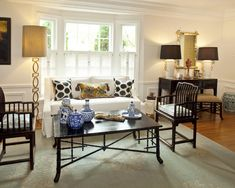 Beautiful Cafe Style Shutters and Curtains : Adorable Eclectic Living Room With White Cafe Style Shutters With Lattice Also Dark Brown Classic Wooden Coffee Table And Armchairs Also Elegant Floor Lamp Design Also White And Black Cushions Color