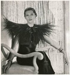 Elsa Schiaparelli design, 1933.   Moved the center of interest into the shoulder, which she began to widen, accentuated them by pleats, padding,  braid.  This silhouette remains popular through WWII.