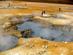 Námafjall, Iceland - Lots of tourists head down to Iceland's Golden Circle, but some of the craziest geothermal activity is up north. Here at the Námafjall Mudpots near Krafla volcano, the landscape is otherworldly.