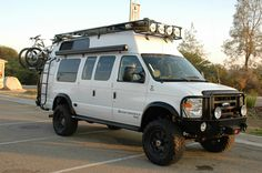 Sportsmobile van with Aluminess winch bumper, roof rack, ladder, and other off road accessories. 4x4 Camper Van, Off Road Camper, Vans Top, High Top Vans, Ford 4x4, Van Roof Racks, Ambulance, Lifted Van, Land Rover Defender
