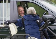 Something funny? The Duke of Edinburgh was glad to share a joke with a passer-by who rode aboard a buggy at the Royal Windsor Horse Show today, 14 May 2015
