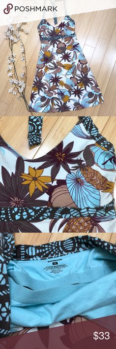 PATAGONIA halter sundress, S. Beautiful organic cotton sundress by Patagonia, size small. Cream, tans, browns, blues. Halter tie with a shelf bra. Perfect condition. Bust measures 14 inches across and stretches to about 18, waist comfortably stretches to about 15 inches, length is about 35 inches depending on the tie. Really beautiful, really nice! Patagonia Dresses