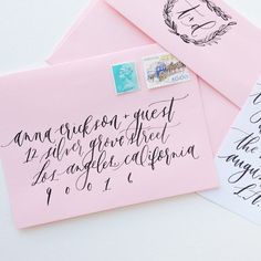 blush envelopes and black calligraphy