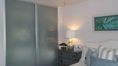 How simple but beautiful are frosted glass closet doors!