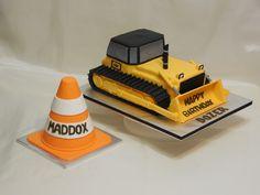 Bulldozer cake with traffic cone smash cake