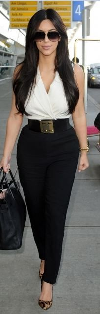Kim Kardashian in Stella McCartney pants, Walter Steiger heels, and Hermes bag, October 2011
