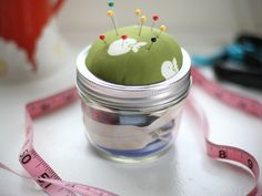 I've been collecting several jars in all shapes and sizes with the intention of making pin cushions and/or mini sewing kits for gifts kinda like this one. Though I'd like to make a fabric binding around the lid.