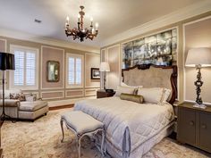 MASTER SUITE with paneled walls, deep crown molding, exquisite chandelier and antiqued mirrored panel behind the bed. Windows have custom shutters and a beautiful view of the backyard and pool. Master Suite, Master Bedroom, Custom Shutters, Pretty Bedroom, Amazing Spaces, Beautiful Bedrooms, Luxury Homes, New Homes, Relax