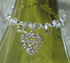 Wedding Wine Bottle Charm Wine Glass Silver Heart Charm Glass Silver Bead Table Decoration by lakehousejewelrybd W007. $5.50, via Etsy.