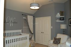Style with Wisdom: Grey and Yellow Nursery - name sticker on the wall above the crib.
