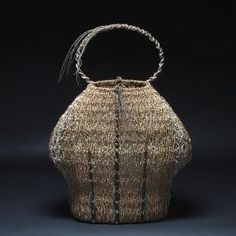 Samuel Yao | Palm Baske; Handwoven sculptural basket with material from palm tree inflorescence.