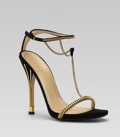 Gucci Golden Cage T-Strap Sandals  These museum-worthy sandals are a cool $1495 at gucci.com.