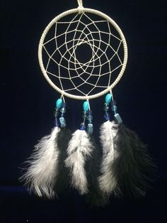 Gray 6 inch Dreamcatcher With Blue Beads and Black & White Feathers by BohoDaze on Etsy https://www.etsy.com/listing/217433478/gray-6-inch-dreamcatcher-with-blue-beads