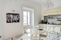 A classy chic apartment in central Milan by Nomade Architettura http://www.nomadearchitettura.com/#all  Restart kitchen, stainless steel, marble custom design floor, bohemian chandelier