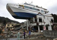 A tsunami left a ship sitting on top of a house. Whoa!