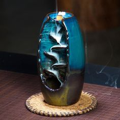 Our splendid, Mountain River Handicraft Incense Holder, Back-Flow Incense Burner has been carefully handcrafted of beautiful, glazed ceramic. When the incense cone is lit, the trail of smoke mimics a waterfall flowing down a mountainside. Feng Shui, Burning Incense, Incense Burner, Ceramic Incense Holder, Incense Cones, Incense Sticks, Glazed Ceramic, Artisanal, Handicraft