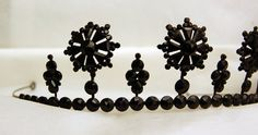 Mourning Tiara (detail), United Kingdom (19th-20th c.; faceted black glass, brass). © Trustees of the British Museum.