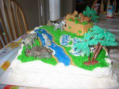 Buttercream icing - all animals, except for alligator, are plastic.