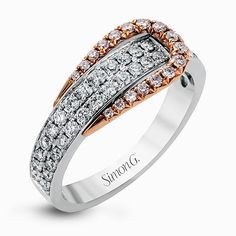 The eye-catching buckle design of this contemporary white and rose gold ring is highlighted by .65 ctw of round cut white diamonds.