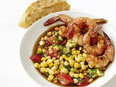New Orleans Shrimp - Food Network --- Easy & kid-approved!  I already had peeled tail-on shrimp in the freezer, so I used the tails to make the broth and served the shrimp without tails.  I also doubled the corn.  I'll probably reduce the butter from 4 Tab. to 3 Tab next time.