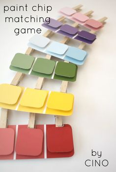 Paint Chip matching game using paint chips, wooden pegs and glue.