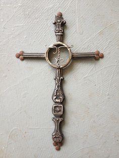 Scrap metal cross by Birmingham metal artist Catherine Partain.