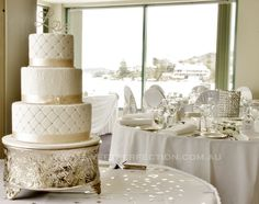"""Classic Ivory Wedding Cake with champagne ribbon and diamante trim, with diamante """"Love"""" topper. Belmont, Lake Macquarie, 2012."""