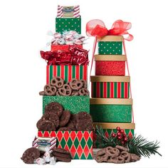 $44.00 The Treat Tower (GR) | Our five tier Seasons Greeting Tower is filled with delicious snacks that will put a smile on any recipients face.