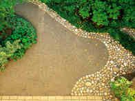 This pathway features pebbles and gravel set in concrete for a visually-interesting edging. I really like the gravel edging.