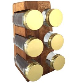 Acacia Wood Stand with Spice Jars -- Made from a warmly finished acacia, this carved wooden spice rack comes with six glass jars, which you can fill with finds from your local spice shop or bulk-bought flavors you love. The recycled glass jars are topped with gold-hued lids, pairing handsomely with the rich grain of wood that intensifies over time. Whether displayed horizontally or vertically, this spice rack tucks in perfectly with your favorite kitchen tools and culinary must-haves.