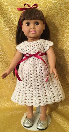 A personal favorite from my Etsy shop https://www.etsy.com/listing/261479067/white-and-silver-crocheted-dress-for-18