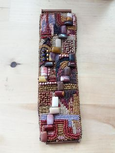 Bracelet by VeroniqueV- All embroidered seed beads, glass beads and mookaite.